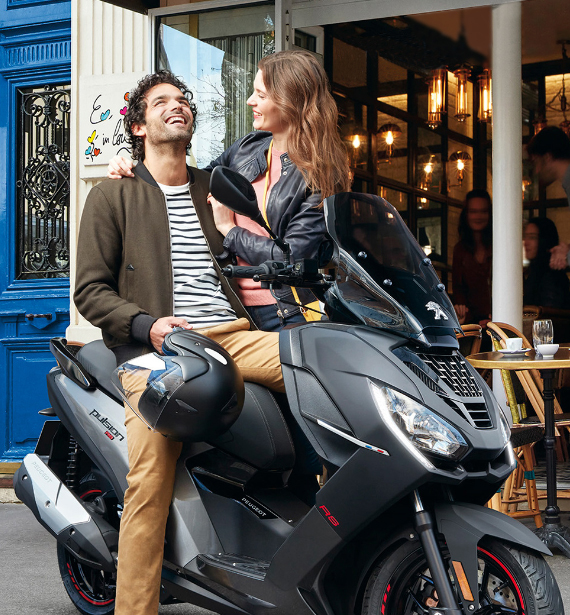 Man and woman on Moteo motor