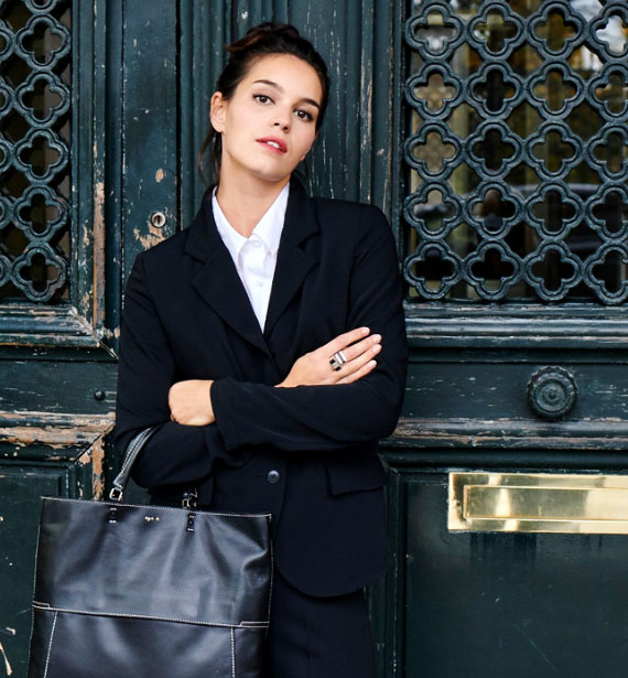 Young woman with black purse and black jacket