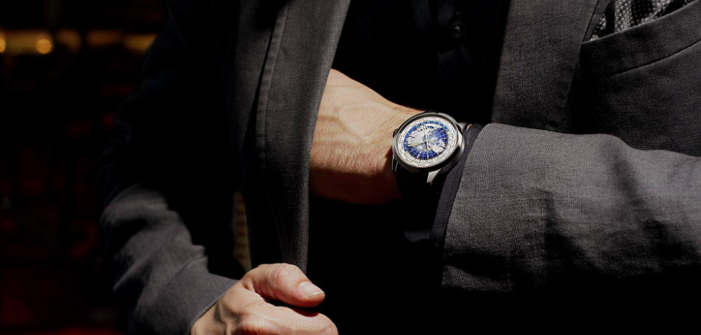 Hands of a man with a Jaeger-LeCoultre watch