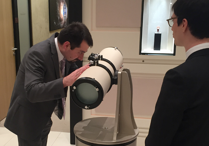 Man looking into the telescope of Jaeger-Le-Coultre event experience