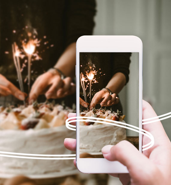 Taking picture of a birthday cake