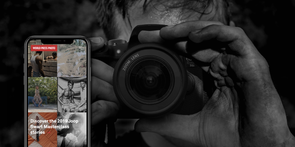 Picture of photographer with a camera and the WPPF website on a smartphone